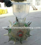mini manual hand pushing fertilizer and seed machine